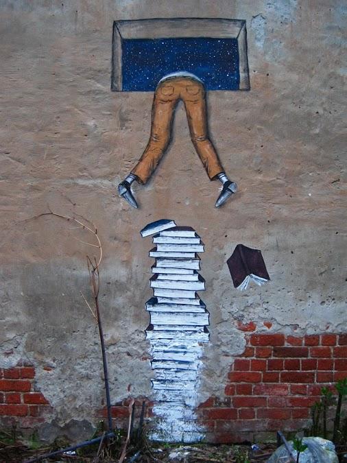 Street-Art-Climb-Over-Books